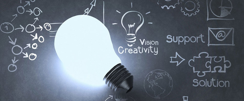 Stock photo of a light bulb with a background that says vision and creativity.